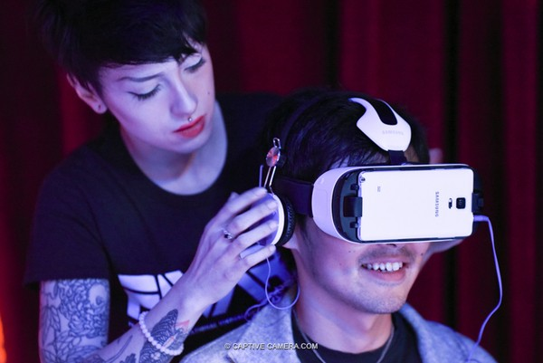 An attendant helps a patron with a Samsung Gear VR at FIVARS in Toronto, 2015
